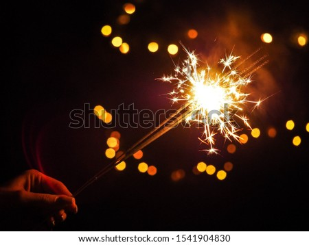 A Sparkler with a Dazzling Flame #1541904830