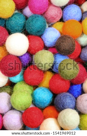 background of colourful felt balls used as christmas oranments #1541969012