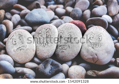 managing emotions emoji faces on stones - sad, happy, surprised worried and angry feelings draw . #1542091328