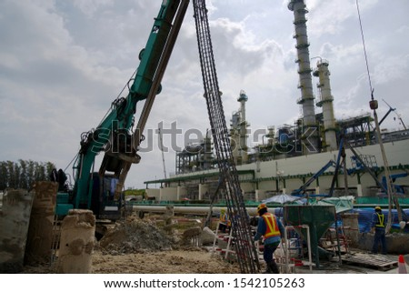 Bored pile work for foundation of building by machine. Working boring pile in petrochemical plant. #1542105263