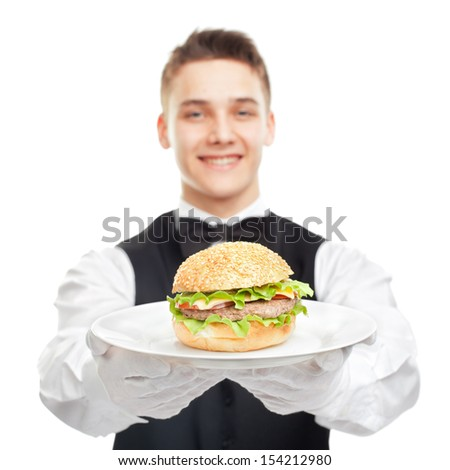 young happy smiling waiter holding hamburger on plate isolated on white background #154212980