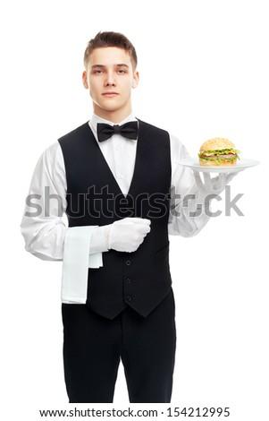 Portrait of young waiter holding hamburger on plate isolated on white background #154212995