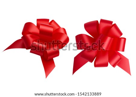 A set of two bows of the same shape photographed from different angles made of red bright shiny satin ribbon isolated on a white background. Design elements, clipping path. #1542133889