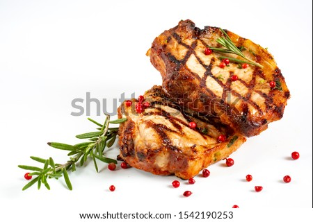 Home cooking grilled meat. Perfectly seasoned, juicy, delicious grilled pork chops with strips sprinkled with fresh coriander  #1542190253