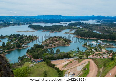 Panoramic view from Rock of Guatape in Medellin, Colombia. Guatape view Peñol stone in colombia great view of a lake in Guatape, Antioquia. Colombia tourist site. View from the top of the Peñol stone #1542201617