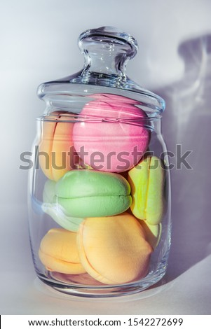 Sweet dessert in a transparent glass jar. Colored marshmallows. Multi-colored macaroons. #1542272699
