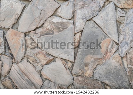 Stone wall background. Vintage wall is stone is old vintage in background home. #1542432236