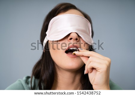 Portrait Of Blindfolded Young Woman Testing Food #1542438752