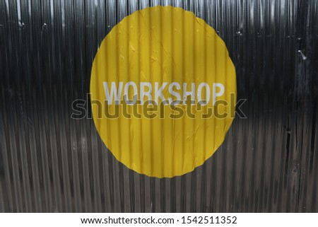 Symbol and emblem word Workshop on the yellow Background #1542511352