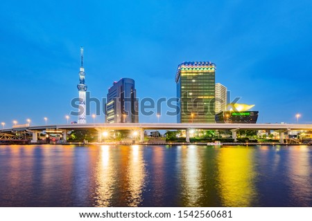 Cityscape of Tokyo skyline, panorama view of office building at Sumida river in Tokyo in the evening. Japan, Asia.  #1542560681