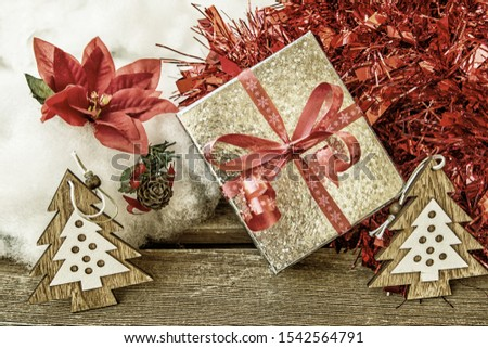 Christmas image with gifts, poinsettia, and Christmas ornaments