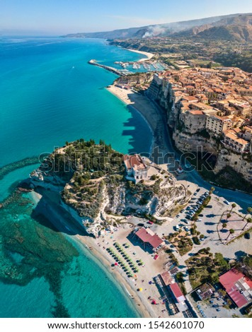 Aerial view of Tropea, house on the rock and Sanctuary of Santa Maria dell'Isola, Calabria. Italy. Tourist destinations of the most famous in Southern Italy, seaside resort located on a cliff #1542601070