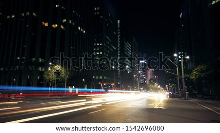 Beautiful night of Seoul road traffic, view on the busy intersection in Gangnam District. Cars, buses and other vehicles passing by creating picturesque light trails. #1542696080