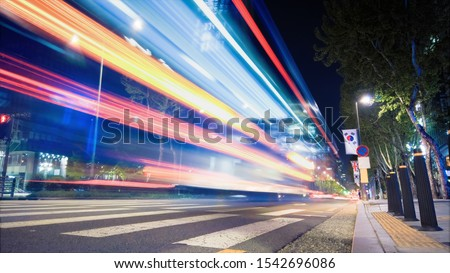 Beautiful night of Seoul road traffic, view on the busy intersection in Gangnam District. Cars, buses and other vehicles passing by creating picturesque light trails. #1542696086