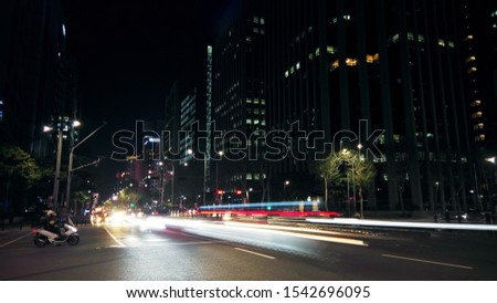 Beautiful night of Seoul road traffic, view on the busy intersection in Gangnam District. Cars, buses and other vehicles passing by creating picturesque light trails. #1542696095