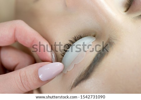 Eyelash Care Treatment: eyelash lifting, staining, curling, laminating and extension for lashes.  Close up of beauty model's face with perfect fresh skin and long eyelashes, lash lift laminate. #1542731090