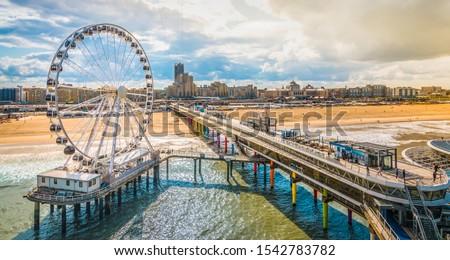 Scheveningen, The Hague, The Netherlands. Ferris wheel and pier at the beach. #1542783782