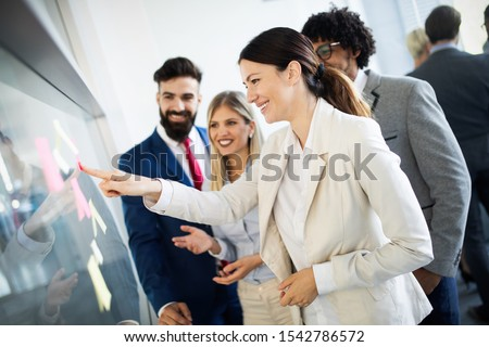 Group of happy business people working in a meeting at office #1542786572