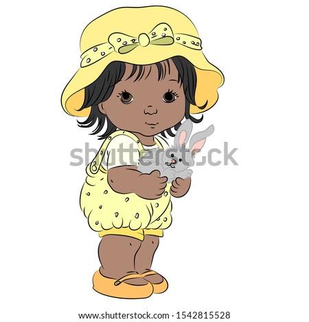 A little girl holding a rabbit