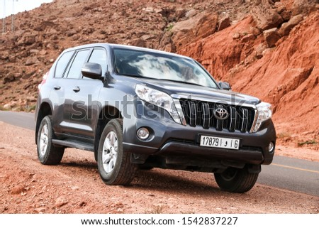 Al Haouz Province, Morocco - September 23, 2019: Offroad car Toyota Land Cruiser Prado 150 at the countryside. #1542837227