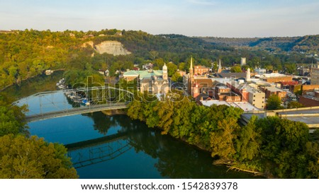 The Kentucky River meanders along framing the downtown urban core of Frankfort KY #1542839378
