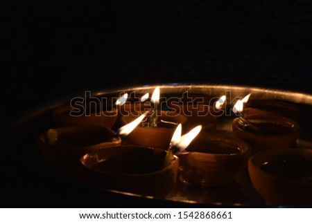 lamps in plate. Diyas. Earthen lamps. Diwali. #1542868661