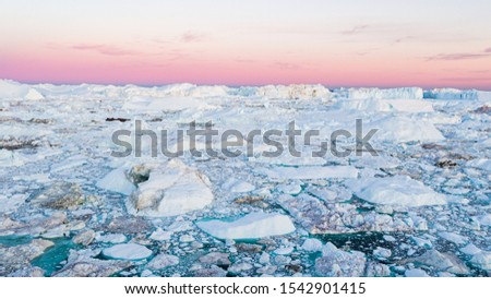 Global warming - Greenland Iceberg landscape of Ilulissat icefjord with giant icebergs. Icebergs from melting glacier. Arctic nature heavily affected by climate change #1542901415