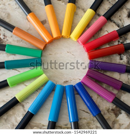 An array of markers from all colors of the rainbow grouped together interesting ways. #1542969221