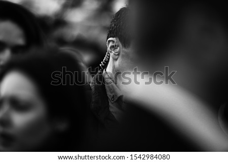 Protection and Guard Service (SPP, Romanian version of the US Secret Service) officer is on guard during a public visit of a dignitary.  Royalty-Free Stock Photo #1542984080