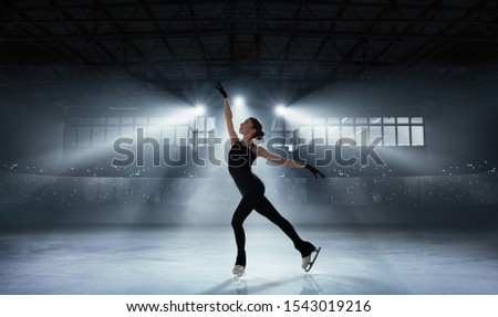 Figure skating girl in ice arena. Royalty-Free Stock Photo #1543019216
