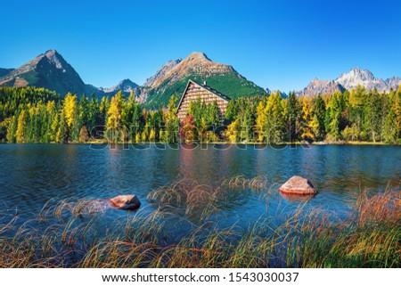 Sunset in  Strbske pleso  (Strbske lake) beautiful lake in High Tatras mountains, Slovakia #1543030037