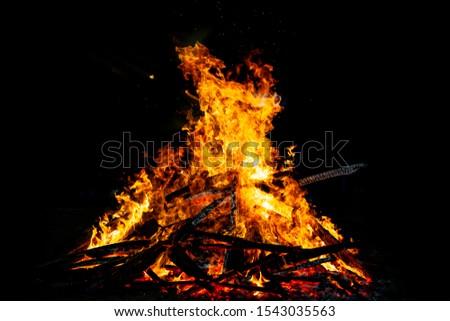 Bonfire that burns on a dark background, wood burning flame. #1543035563