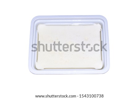 Feta cheese in a package on a white background.Background of the feta cheese. #1543100738
