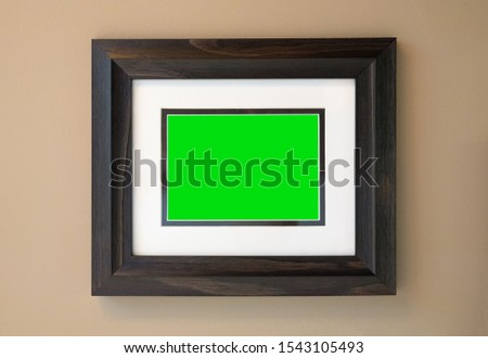 Empty Picture Frame and Matte over Chroma Key Green