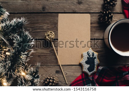 Christmas background with fir tree and decoration on dark wooden board. Christmas mood. Flat lay winter cozy vintage background. Vintage paper with copy space; overhead view. #1543116758