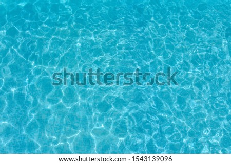 Texture of water surface. Overhead view, Swimming pool bottom caustics ripple and flow with waves background. #1543139096