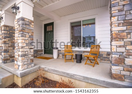 Front porch glass paned door yard and outdoor stairs at the facade of a home #1543162355