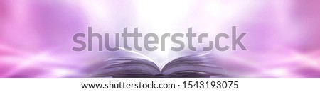 Imagine a picture book of an ancient book opened on a wooden table with a sparkling golden background. With magical power, magic, lightning around a glowing glowing book In the room of darkness #1543193075