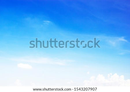 Blue sky background and white clouds soft focus, and copy space. #1543207907