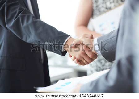 Man in suit shake hand as hello in office closeup. Friend welcome mediation offer positive introduction greet or thanks gesture summit participate approval motivation strike arm bargain concept. #1543248617