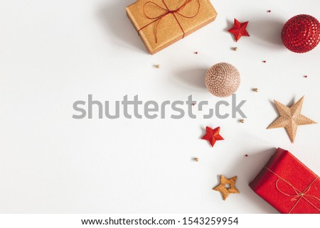 Christmas composition. Gifts, red and golden decorations on gray background. Christmas, winter, new year concept. Flat lay, top view, copy space #1543259954