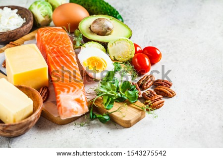 Keto diet food concept. Fish, eggs, cheese, nuts, butter and vegetables - ingredients keto diet. #1543275542