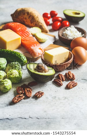 Keto diet food concept. Fish, eggs, cheese, nuts, butter and vegetables - ingredients keto diet. #1543275554