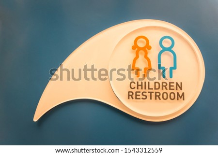 Children's bathroom symbol on white and blue wall background