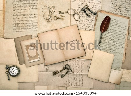 open book, antique accessories, old letters, post cards, glasses, keys, clock. nostalgic background. memories. vintage style picture