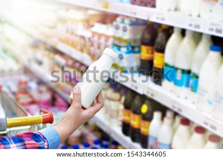 Woman shopping dairy product in grocery store #1543344605
