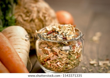 Dry celery, dry ccarrot, dry persley and dry onion - small pieces of dried vegetables in jar #1543371335