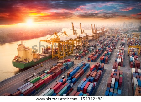 Logistics and transportation of Container Cargo ship and Cargo plane with working crane bridge in shipyard at sunrise, logistic import export and transport industry background #1543424831