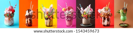 Different delicious freak shakes on colorful background #1543459673
