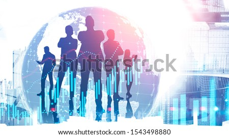Silhouettes of business people in city with double exposure of world map and blurry financial charts. Concept of international company. Toned image. Elements of this image furnished by NASA #1543498880